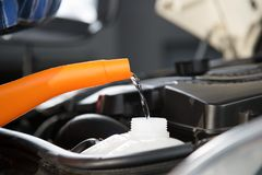 Car Water refill. A closeup view from refilling a car with fresh water royalty free stock image