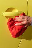 Car with wax and polish cloth. Royalty Free Stock Photography