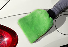 Car with wax and polish cloth. Hand with cloth washing a car. Waxing and polishing Royalty Free Stock Images