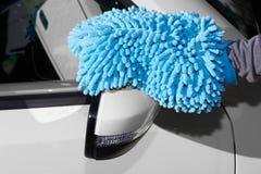 Car with wax and polish cloth. Hand with cloth washing a car. Waxing and polishing Stock Image