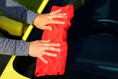 Car with wax and polish cloth. Hand with cloth washing a car. Waxing and polishing Stock Photography