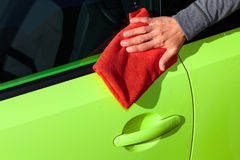 Car with wax and polish cloth. Stock Photos