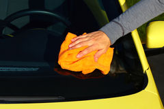 Car with wax and polish cloth. Hand with cloth washing a car. Waxing and polishing Royalty Free Stock Photography