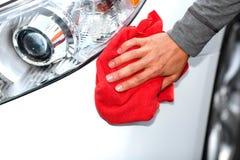 Car with wax and polish cloth. Hand with cloth washing a car. Waxing and polishing Royalty Free Stock Image