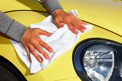 Car with wax and polish cloth. Royalty Free Stock Photo