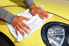 Car with wax and polish cloth. Royalty Free Stock Photo