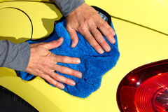 Car with wax and polish cloth. Hand with cloth washing a car. Waxing and polishing Stock Photos