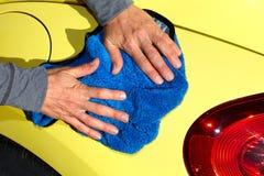 Car with wax and polish cloth. Stock Photos