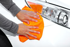 Car with wax and polish cloth. Hand with cloth washing a car. Waxing and polishing Stock Images