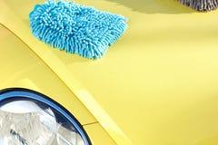 Car with wax and polish cloth. Waxing and polishing Stock Image