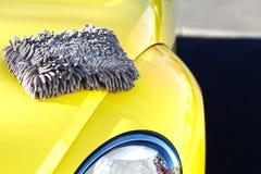 Car with wax and polish cloth. Waxing and polishing Stock Photos