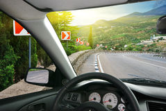 Car on the way. Into the car. Road in mountain Stock Image