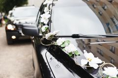 The car in wedding cortege. Decorated with flowers Stock Photo