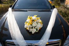 Car wedding decoration. Front of a black decorated car for a wedding ceremony Royalty Free Stock Photos