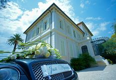 Car wedding decoration. The car decorated for wedding ceremony as it placed in front of the beautiful building Stock Photography