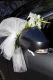Car wedding decoration. Front of a black decorated car for a wedding ceremony Stock Photography