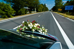 Car during wedding with flowers up front Royalty Free Stock Image