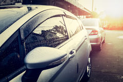Car is wet with dew in the morning Stock Photo