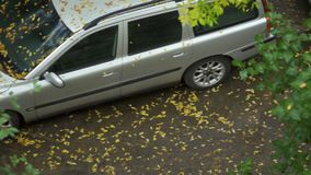 The car is on wet pavement. Puddle on a rainy autumn day. stock video footage