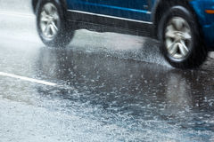 Car on wet road Royalty Free Stock Photography