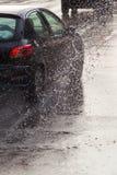 Car on a wet street at heavy rain Stock Photo