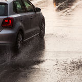 Car on a wet street at heavy rain Stock Images