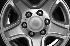 Car wheel. Gray car wheel, black and white stock photo