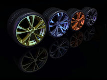 Car wheel. Image of car wheels on a black, glossy background Royalty Free Stock Photography