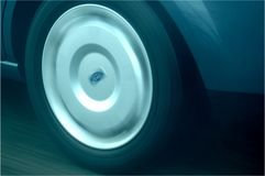 Car wheel. At speed on highway Stock Photo