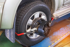 Car wheel alignment. At service station center Royalty Free Stock Photos