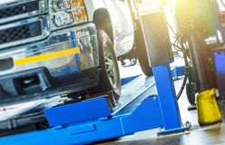 Car Wheel Alignment Check. Large Pickup Truck on the Alignment Equipment in the Car Service Royalty Free Stock Image