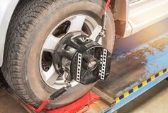 Car wheel alignment maintenance for balance. Close up car wheel alignment maintenance for balance at service station center royalty free stock photo