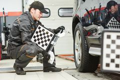 Car wheel alignment service work Royalty Free Stock Photo