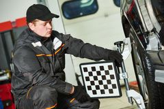 Car wheel alignment service work Stock Photos