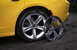 Car wheel with alloy rim and chrome rims cover Royalty Free Stock Images