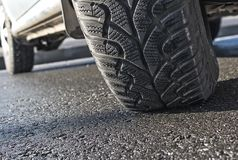 Car wheel on asphalt closeup royalty free stock photos