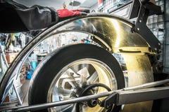Car Wheel Balancer in Action. Vehicle Tire Wheel Balancing in the Auto Service. Seasonal Maintenance royalty free stock photos