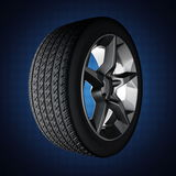 Car wheel on blue background Royalty Free Stock Photos