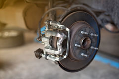 car wheel brake disc and shoes of lifted automobile at repair s royalty free stock photo