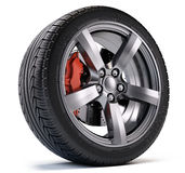 Car wheel with breke disc and caliper  on white Royalty Free Stock Photos
