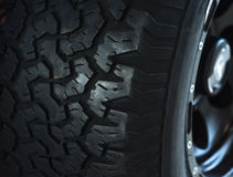 Car wheel on a car, close-up, low key Royalty Free Stock Image