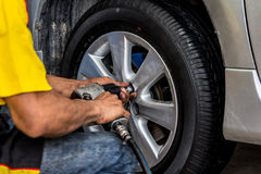 Car wheel changed by mechanic Royalty Free Stock Photo