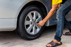 Car wheel changed by mechanic Royalty Free Stock Photography
