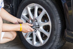 Car wheel changing Stock Photos