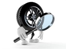 Car wheel character looking through magnifying glass. Isolated on white background Stock Photo
