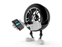 Car wheel character using calculator. On white background Royalty Free Stock Photo