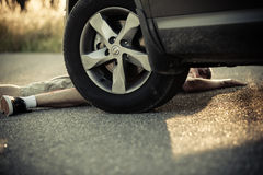 Car wheel close to injured child on street Royalty Free Stock Photography