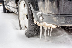 Car wheel covered with snow on a winter day Royalty Free Stock Photos