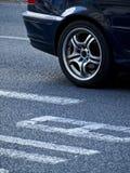 Car Wheel Detail. Detail of BMW wheel next to the bus lane stock images