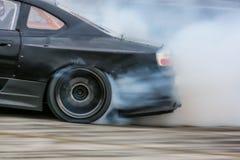 Car wheel drifting and smoking on track. Car wheel drifting and smoking on track Stock Photos